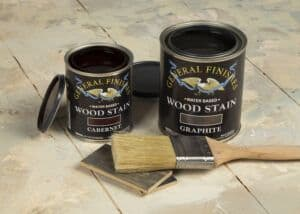 gf-styled-photo-new-WATER-BASED-WOOD-STAIN-colors-angle-open-can-cabernet-graphite-lids-color-chips-brush-bristle-general-finishes-2019